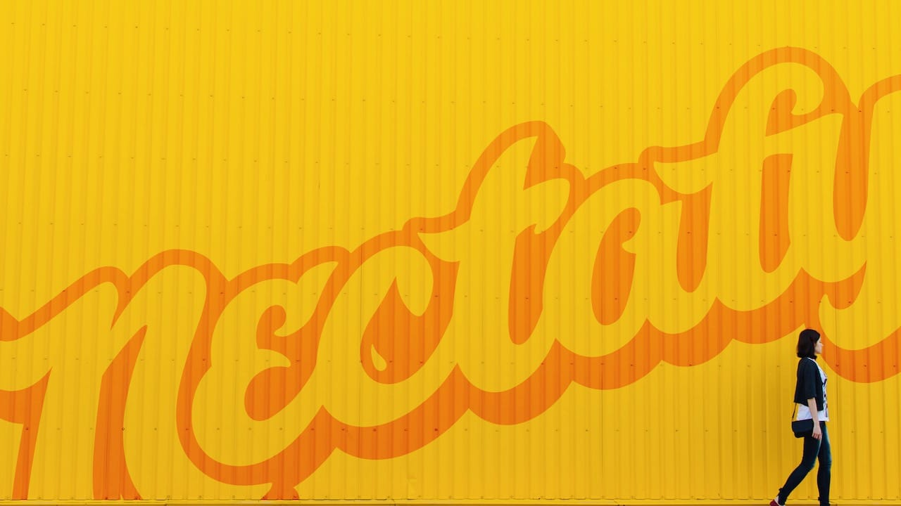 Nectafy logo on yellow wall