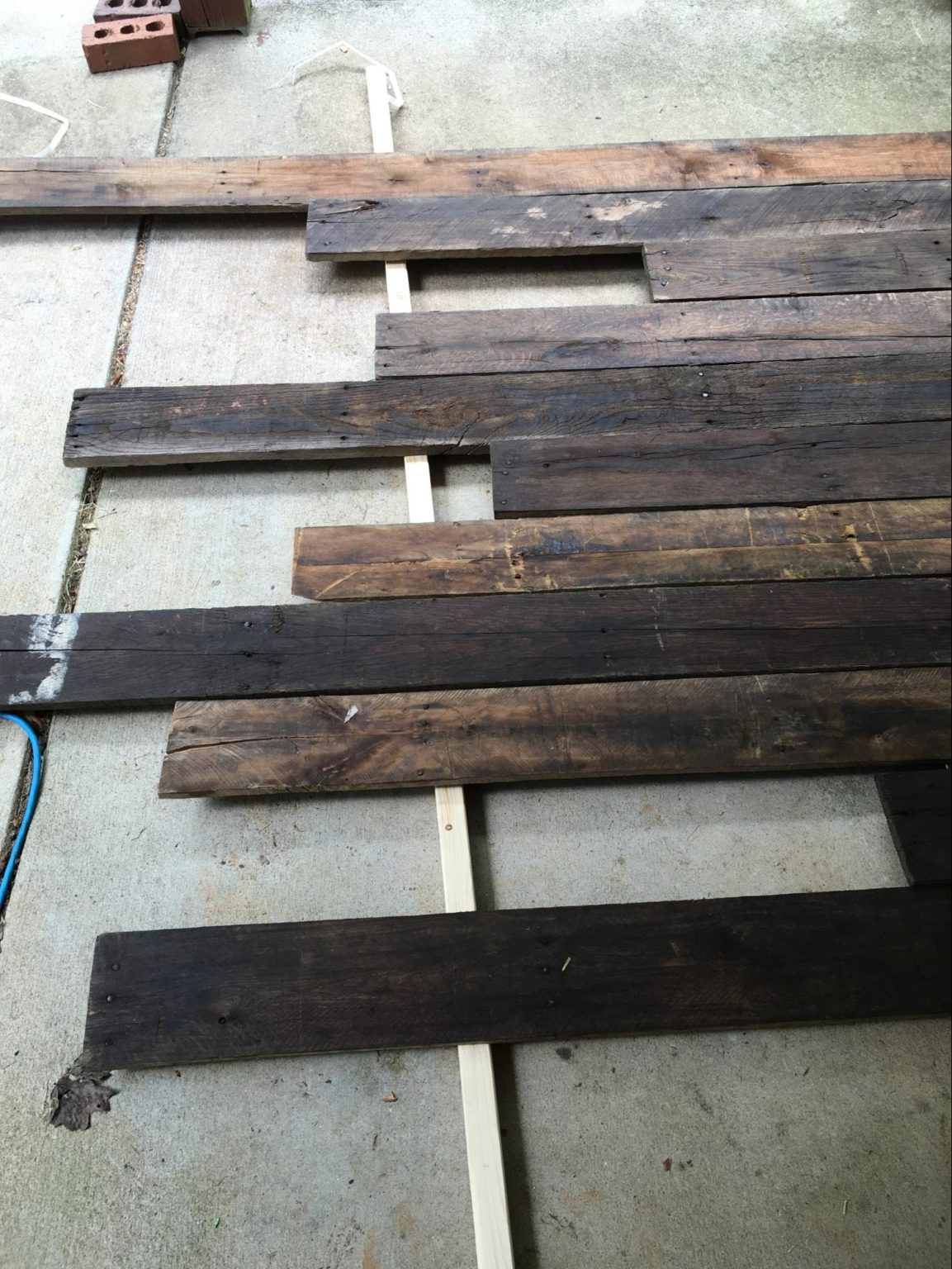 How to build wood wall backdrop for home office - Anyvoo - Staining the wood