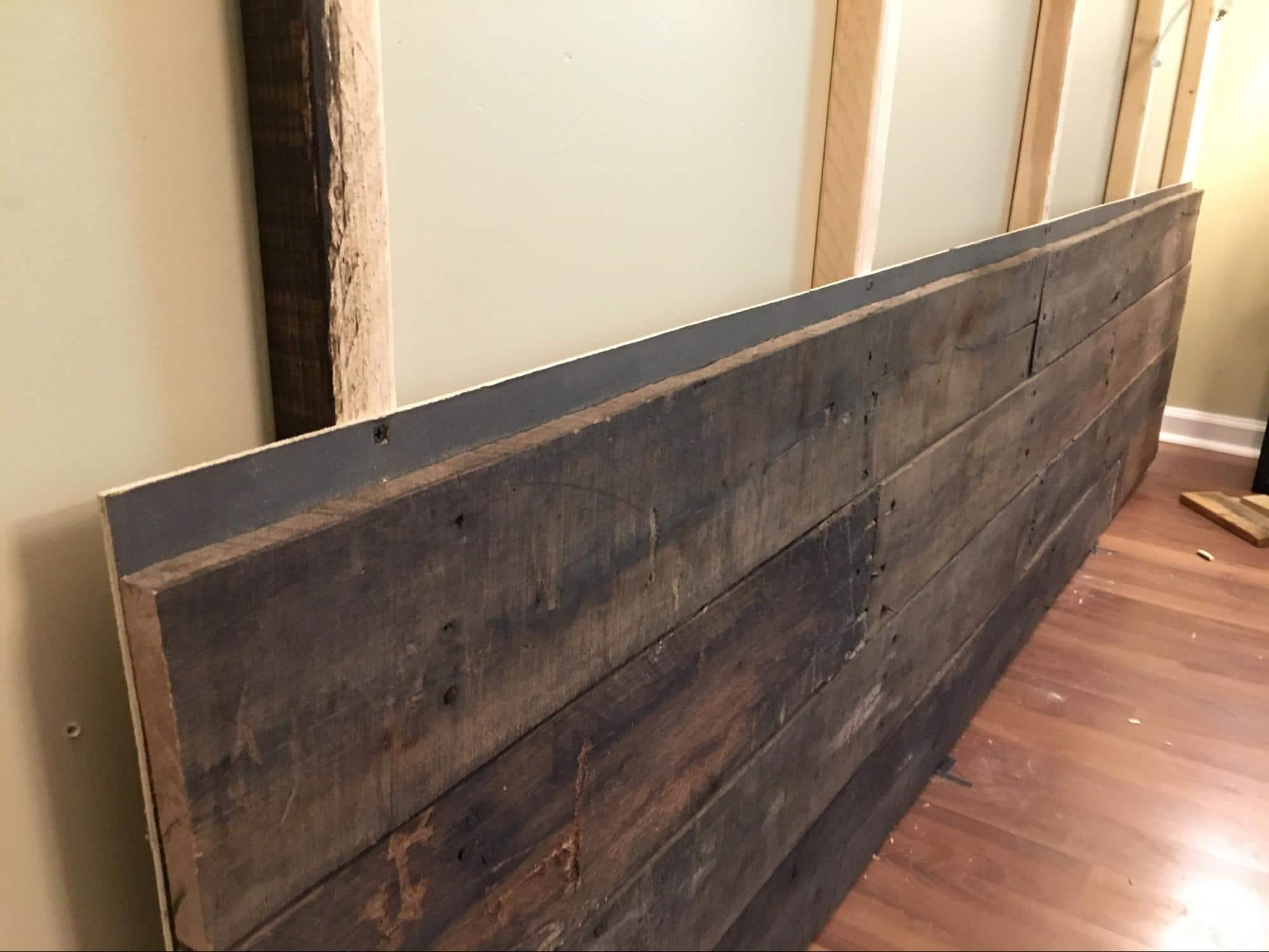 How to build wood wall background for home office - Anyvoo - Bottom piece of wood wall mounted to frame